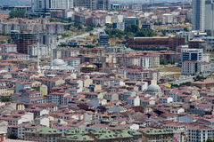 Top urban view of lots  houses in Istanbul city, Turkey. Crowded red roofs and mosque. Stock Photography