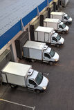 Top viev Trucks loading unloading at warehouse. stock image