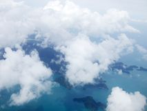 Top view 1. A top view from sky - island, sea, ocean, clouds Royalty Free Stock Images