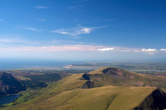 Top view. View to the west from Snowdon mountain in Wales far on the horizon you can see holyhead royalty free stock images