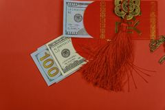 Top view accessories Chinese new year festival decorations on red background. And US dollar money red packet royalty free stock photos