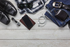 Top view accessories to travel with man clothing concept. Stock Photos