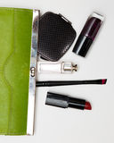 Top view accessories for woman. Stylish sunglasses, green bag , lipstick , perfume , fashion   flat lay on white Stock Photo