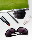 Top view accessories for woman. Stylish sunglasses, green bag , lipstick , perfume , fashion   flat lay on white Stock Photos