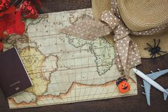 Top view of accessory Happy Halloween with items to travel background concept. Mix several object on the modern rustic brown wooden at home office desk Stock Images