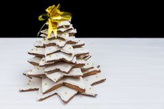 Top view of adorable homemade gingerbread Christmas tree on whit. E wooden desk. Mockup for seasonal offers and holiday post card Stock Images