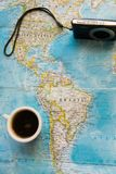 Top view of adventure flat lay with coffee  cup and camera. Explore the new world or planing the vacation. With cup of coffee Royalty Free Stock Image