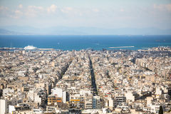 Top View of the Aegean sea and streets labyrinth of Greek capital Athens. Royalty Free Stock Images