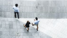Top view aerial of business people walk in pedestrian street Stock Photos