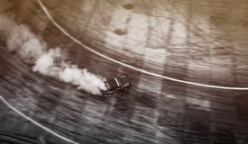 Top view of aerial from drone. Professional driver drift car on. Asphalt track.Motor sports concept royalty free stock photography