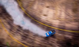 Top view of aerial from drone. Professional driver drift car on. Asphalt track.Motor sports concept stock images