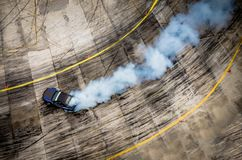 Top view of aerial from drone. Professional driver drift car on. Asphalt track.Motor sports concept stock photo