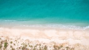 Top view aerial image from drone of an stunning beautiful sea landscape beach with turquoise water. With copy space for your text.Beautiful Sand beach with Stock Photo