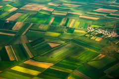 Top view aerial photo of settlements and fields. Aerial photo from a plane, top view, field roads and city Royalty Free Stock Photos