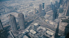 Top view, aerial photography with quadrocopters Dubai bird`s-eye view. Many skyscrapers and the automobile multi-level interchange. City Point in the Emirates stock video footage
