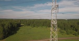 Top view, aerial: power lines. Electric high-voltage supports. Transmission of electricity by wire. 4K. Top view, aerial: power lines. Electric high-voltage stock video