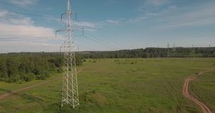 Top view, aerial: power lines. Electric high-voltage supports. Transmission of electricity by wire. 4K. Top view, aerial: power lines. Electric high-voltage stock footage