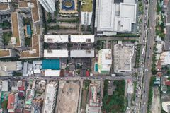 Top view aerial view of modern condominium building with house a. Nd flat and city road stock photo
