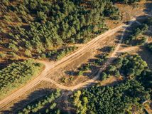 Top view or Aerial view of wild road among autumn forest, photo from drone Royalty Free Stock Photography
