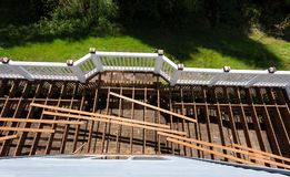 Top view of an aged outdoor wooden cedar deck being tore down due to weathered boards. Overhead view of aged outdoor wooden cedar deck being tore down stock photography