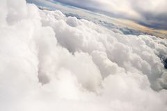 Top view from airplane at the clouds and sunset Stock Photography