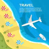 Top view of airplane flying over seashore with umbrellas and boats Royalty Free Stock Photo