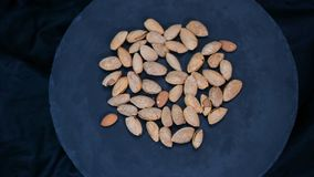 Top view of almonds on dark stone table. Top view of almonds on dark stone table stock footage