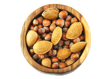 Top view of almonds and nuts in a handmade wooden Stock Images