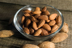 Top view of Almonds over wooden background Royalty Free Stock Images