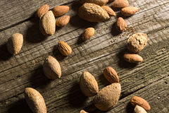 Top view of Almonds over wooden background Royalty Free Stock Photo