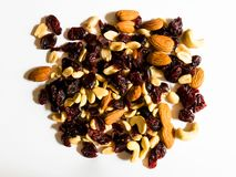 Top view of almonds, peanuts, cashew nuts and dried cranberries on white background royalty free stock photo