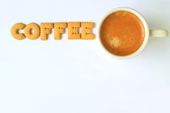 Top view of alphabet shaped biscuits, spelling the word COFFEE with a cup of coffee on white background. With free space for text and design Stock Images