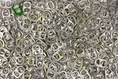 Top view of aluminum ring pull for background. Can metal white isolated tab beer recycle object beverage tin lid drink open silver soda cap food metallic opener stock photography