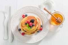 Top view of american pancakes with berries. On white table Royalty Free Stock Photos