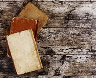 Top view of ancient books. On wooden table stock images