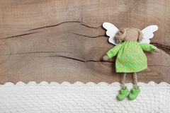 Top view of angel with crochet strip on wooden background for ch Stock Photo