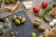 Top view antioxidant green olives in black plate. Background Royalty Free Stock Image