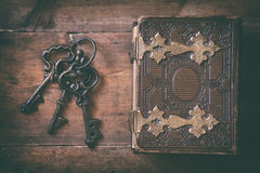 Top view of antique book cover and old keys Stock Photography