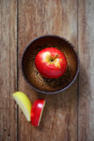 Top view apple in wood bowl Royalty Free Stock Photo