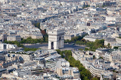Top view Arch of Triumph and Etoile square Paris. Top view on Triumphal Arch and Etoile square, roofs, housetops, city residential quarters and downtown, center stock photography