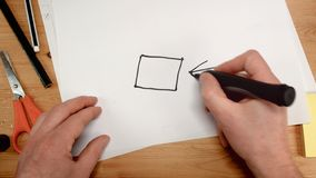 Top view, an architect`s hand draws the square base for a house, ideal footage for topics such as building renovation royalty free stock photos
