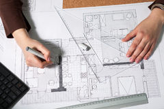 Top view of architect working at her desk Royalty Free Stock Photos