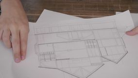 Top view of architect working on a house plan. Architect working on a house plan stock footage stock video footage