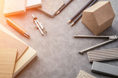 Top view of architects table with stuff of modern house with mat Royalty Free Stock Photo