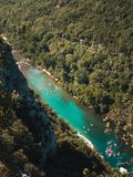 Top view on the Ardeche with numerous canoes. Top view on the River Ardeche with numerous canoes stock image