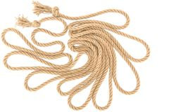 Top view of arranged brown nautical rope with knots. Isolated on white royalty free stock photos