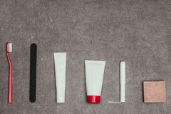 Top view of arrangement of feminine hygiene supplies. On grey surface Stock Images