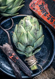 Top view artichoke still life with vintage scissors Royalty Free Stock Image