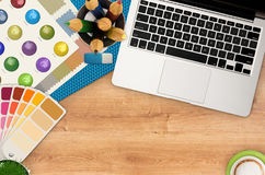 Top view artist workspace. On wooden background Royalty Free Stock Image
