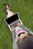 Top view of asian business woman typing on the laptop royalty free stock image
